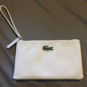 White Lacoste clutch